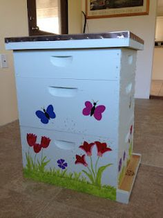 My incredibly cute bee hive -- that I painted myself! (A little biased here, but I think it may be the cutest bee hive ever) Bee Hives Boxes, Bee Boxes, Hives And Honey, Honey Bees, Beehive Design, Bee Hive Plans, Bee Drawing, Pet Bird Cage, Raising Bees