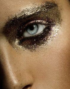 Black and gold glitter eye makeup.