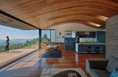 The Ceiling In This Modern House Echoes The Shape Of The Hillside It Sits On