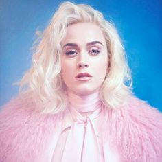 Love Katy Perry's bleach blonde, wavy hairstyle + power pink ensemble.