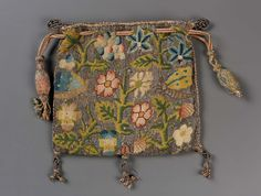 Drawstring bag (image 1) | England | late 16th-early 17th century | Linen plain weave embroidered with silk and silver metallic threads Braided silk and metallic cords and tassels | Museum of Fine Arts, Boston | Accession #: 43.1076