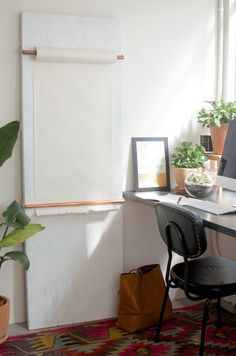 DIY Wall Size Note Board — A Pair & A Spare - http://www.apartmenttherapy.com/office-organization-diy-studio-note-roll-board-a-pair-a-spare-207860