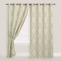 Our curtains feature a fresh aqua and green ikat ogee pattern. With metal grommets in an antique bronze finish, they add a splash of sophisticated global style to your windows.