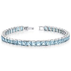 MSRP: $699.99   Our Price: $399.99   Savings: $300.00     Item Number: SB2684(2)   Availability: Usually Ships in 5 Business Days     PRODUCT DESCRIPTION:     Crafted in Sterling Silver, this beautiful bracelet features vibrant Princess Cut Swiss Blue Topaz gemstones bezel set for a sleek and contemporary design. This beautiful bracelet makes the perfect gift for the December Birthday or any occasion.     FEATURES:     Crafted in Fine Sterling Silver   (42) 4.0 mm Princess Cut Genuine Swiss…