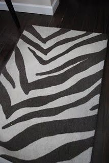 DIY zebra painted rug. Wax paper stencil + latex paint.