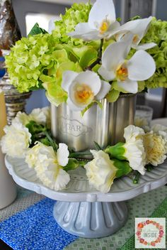 Phalaenopsis Snowball Arrangement surrounded with white carnations for a Mother's Day Table Centerpiece