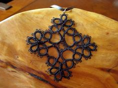 Tatted pendant. I'm going to make this with red seed beads to really goth it up.