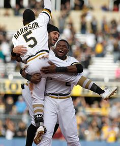 Josh Harrison of the Pittsburgh Pirates celebrates with Sean Rodriguez and…