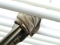 Wrap a pair of tongs in an old T-shirt and rubber bands, then use them to clean your blinds. | 21 Clever Cleaning Tips That Actually Work