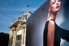 PARIS 1st visit-Strolling up the Champs Elysees I saw this billboard and had to take the photo.