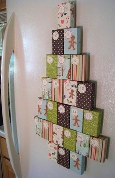 Advent - love this! It is cardboard jewelry boxes wrapped with cute paper, and magnets on the back to put on the fridge - in the shape of a tree :)