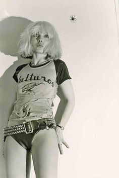 Debbie Harry, 1976. Cool graphic t shirt very sexy in photo with studded cowboy belt, great punk look.