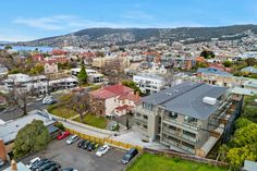 The Sandy Bay Road Apartments. This recently completed apartment complex is perfectly located in an established garden setting on Sandy Bay Road in Battery Point, TAS. Apartment Complexes, Sustainable Design, Apartments, Sustainability, Paris Skyline, Dolores Park, Building, Garden, Travel