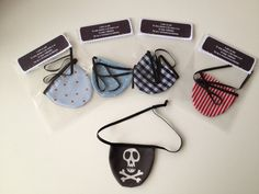 Fabric pirate eye patches with adjustable elastic. Assorted fabric backs.. £4.00, via Etsy.