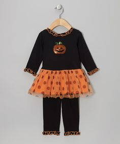 Lil' punkins will be perfectly festive in this precious ruffly tunic and leggings. Sparkles set off the seasonally appropriate graphic, while polka dots round out the adorable pouf factor.