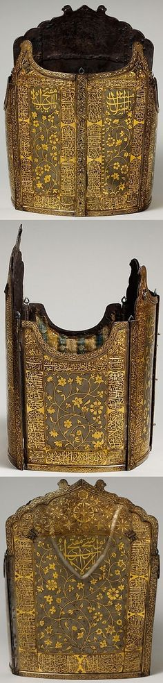 """Indo-Persian char-aina cuirass, late 18th to 19th century, steel, gold, H. 15 1/2 in. (39.37 cm); Wt. 6 lb. 13, Met Museum. The Arabic inscriptions stress God as the God of Light, the rewards He will give His servants, and His punishment of unbelievers and evildoers. The light imagery is particulary appropriate for gold embellished armors of """"four mirror"""" (char aina) type. (the museum says """"probably Indian"""", but it looks Persian to me.)"""