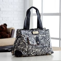 Who says I have to be a frumpy mommy!... Love this bag. CoCaLo Couture Kayla Zebra Satchel Diaper Bag $99.98