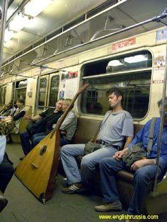 City life: russian balalaika in moscow city subway