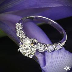 Shared-Prong Diamond Engagement Ring - This dazzling Custom Diamond Engagement Ring is set in platinum and features 0.80ctw A CUT ABOVE® Hearts and Arrows Diamond Melee that frame the gorgeous 1.511ct Expert Selection center diamond.