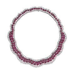 A ruby and diamond necklace. Designed as an undulating band of oval and pear-shaped rubies with circular-cut diamond trim, mounted in platinum, 16 ins. #christiesjewels