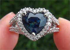 Amazing blue ceylon sapphire and diamond heart shaped ring.  This is actually one of my dream rings.