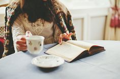 {tea + book + cozy sweater}