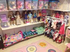 AG Doll Storage!  Goodness.  This is a lot of dolls!  I love the bins for accessories and the PVC hanging rack for clothing.  All the dolls even have a place.  Great organization.  Via Amanda Whitley