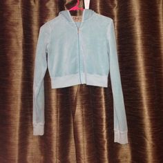 Juicy Couture cropped velour jacket Preloved blue Juicy Couture cropped velour jacket. This jacket is in fantastic condition with no signs of wear and is ready for a new home! Juicy Couture Tops Sweatshirts & Hoodies