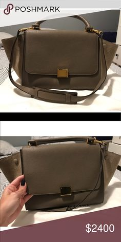Small Celine Trapeze. Excellent condition. Worn only a few times. Almost perfect condition. Comes with Cards and Dust Bag. There is only one tiny mark as shown in photo. It is very unnoticeable since the leather is grained and textured so it blends right in. Inside is clean like new since I only wore it a few times. Celine Bags Shoulder Bags
