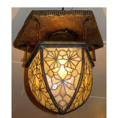 Materials Unlimited - L12077 - Antique Tiffany Stained Glass Ceiling Light Fixture, $8,850.00 (http://www.materialsunlimited.com/l12077-antique-tiffany-stained-glass-ceiling-light-fixture/)