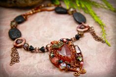 Romance with Rhodonite. Wire wrapped stone that I loved to hold, now it's wearable art! By Gaia Copia.