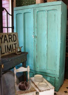 Oh, this light turquoise wardrobe is sensational! In the Entry at Sisters Garden!