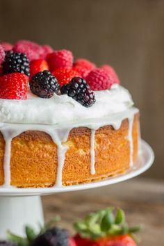 Easy Triple Berry Almond Poke Cake lightened up with Greek Yogurt!