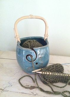 Yarn Bowl Knitting bowl with handle  Robin's Egg by redhotpotteryon etsy. What a great idea.  Hopefully someone will get me one sometime.