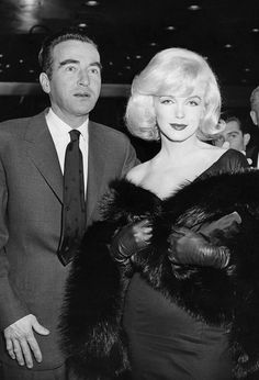 Montgomery Clift and Marilyn Monroe attend the premiere of The Misfits