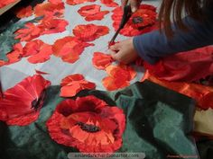Seeking a sense of drama, some of the poppies for the World War 1 exhibition piece are big.