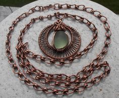 This beautiful handmade necklace is made out of natural copper wire that has been antiqued and beautiful round and smooth sea glass (found in Cape Breton) in a light olive color. Chain length is 20 inches, pendant itself is just over 1 inch wide, 1 inch high and sea glass is 1/2 inch. Price is 45$ (+4$ S/H). For more designs, please visit www.facebook.com/...
