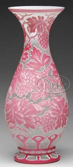 glass, England, A Webb Cameo [glass] vase, carved pink and white over clear cameo pattern of grapes, leaves and branches decorate this monumental size vase. Signed circa 1875-1910