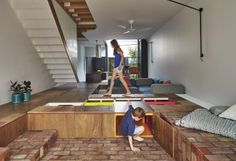 At Mills House, architect Andrew Maynard designed an addition that includes a floor that doubles as a giant toy box.