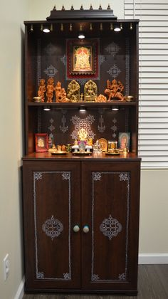 IKEA hack - DIY pooja mandir Wow! DIY with kolam and bells and beads to give it an indian look.