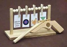 Rubber band gun with targets. My son would love this.
