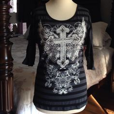 """Buckle Angels & Diamonds Cross Bling T S/M NWT from the Buckle store gorgeous embellished 3/4 sleeve tee with lace panels at sides that go all the way up and under the length of the sleeve! This top is Fantastic!! Tag Sz Small but looks bigger, could easily fit M and possibly L (slightly fitted). Measures 20"""" across chest and 28.5"""" from back of neck all the way down to hem. 50% Cotton 45% Rayon 5% Spandex. Buckle Tops Tees - Long Sleeve"""