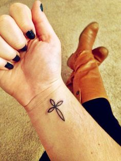 simple cross tattoo on outside ankle except i would want