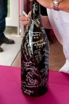 Ask guests to sign a bottle of wine to be opened on a milestone anniversary