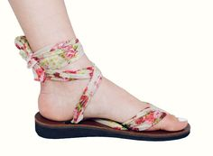 Sseko sandals!  Made in Uganda by girls who are saving up to go to college...the straps of these sandals are attached by loops on the soles so that you can re-tie them in an endless number of designs!