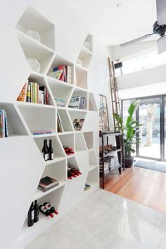 Daga Cafe geometric bookshelf design in white