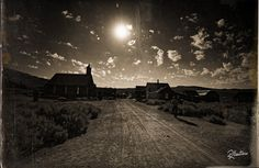 """Bodie Ghost Town Okok, I admit it. Once I'd like to play with one of my photos, this is Bodie, a ghost town of gold miners in California. I worked the photo to obtain the """"old wild west"""" flavour. Just missing Billy the Kid in the frame and the image is complete, but the man on the right with his shadow looks like a gunslinger ready for a duel."""