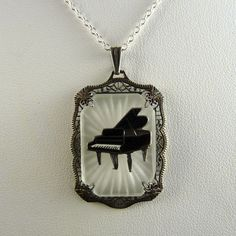 Art Deco Camphor Glass Sterling Pendant with Enamel Piano