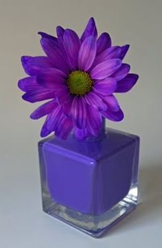 This made me think that you could make this by putting a fake flower in a old nail polish container that you rinsed out and painted the color of your choice