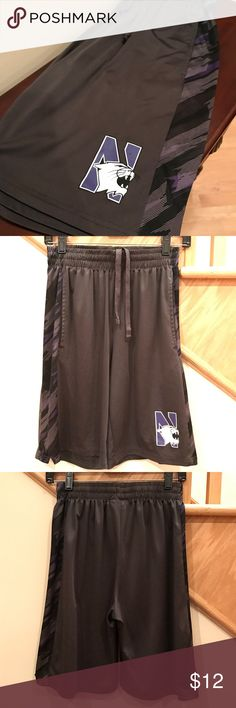 Men's Northwestern Wildcats Shorts NCAA Northwestern basketball shorts by Campus Heritage. Side slip pockets and a drawstring waist. Noticed while photographing there are some missing stitches along the hem, but doesn't seem to impact wearability. Show your support for the Wildcats this year for their NCAA Tournament bid! 🚫Trades🚫PP. Campus Heritage Shorts Athletic